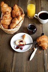Breakfast consisting of croissants, coffee and juice