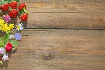 Summer Flowers and Berries on Grunge Wood  Board
