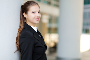 Smiling businesswoman in urban setting