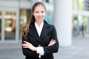 Smiling businesswoman in urban setting