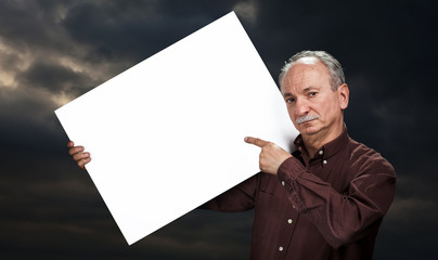 man holding billboard