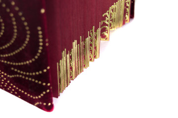 Red velvet with golden book pages isolated on white background