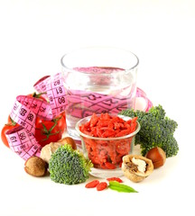 dried goji berries, water, nuts, vegetables for a healthy diet