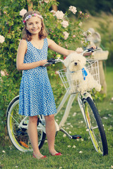 Summer Cycling -  girl with bicycle in the garden