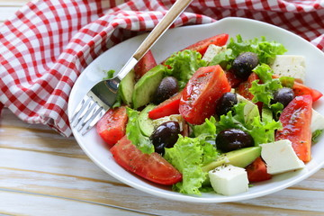Mediterranean salad with olives, lettuce, cheese and tomatoes