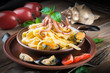 Pasta with mussels and octopus on wooden background
