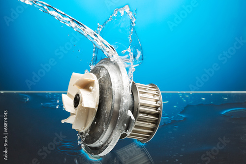 Auto parts, engine cooling pump in water splash on blue backgrou - 66874443