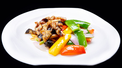chinese stir fry chicken and mushroom  isolated on black