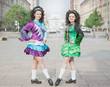 Two women in irish dance dresses posing
