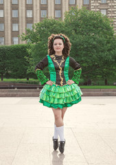 Young woman in irish dance dress posing