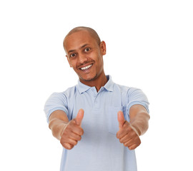 Close-up of a young man showing thumbs up.