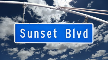 Sunset Blvd sign with time lapse clouds.