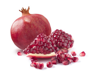 One whole pomegranate and piece isolated on white background