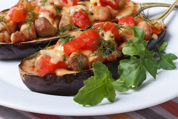 Eggplant half filled with meat, cheese and tomatoes