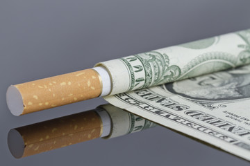 Cigarette which instead of tissue paper dollar.