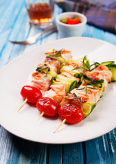salmon skewers with cherry tomatoes and zucchini