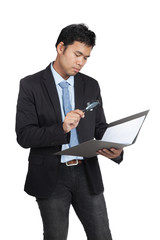 Asian businessman check data in a folder