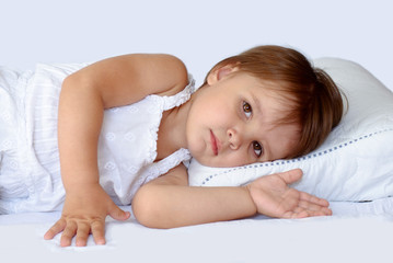 Little girl sleeping on pillow