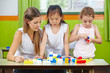 Children playing with building blocks in kindergarten