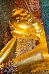 Face of Reclining Buddha gold statue at Wat Pho, Bangkok