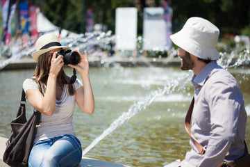 Woman taking a picture of her boyfriend