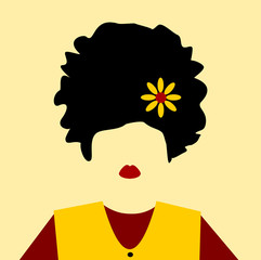 woman with flower in hair and colorful top