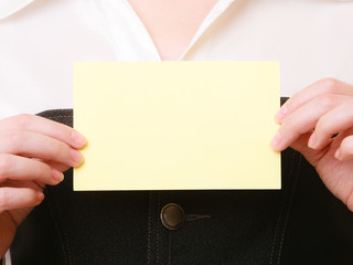 Ad. Blank card in hands of businesswoman