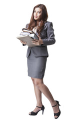 Full length Businesswoman holding documents and notebook