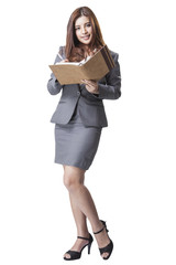 full length business woman attractive with note book and a pen