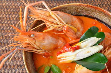 Tom Yum Kung and condiments (Thai cuisine).