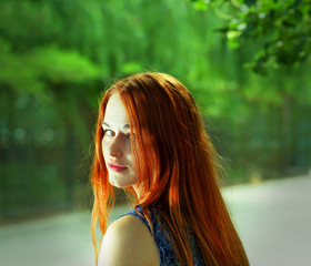 Toned image of pretty women with red hairs outdoors