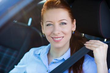 Buckle up. Woman inside black car follows traffic rules