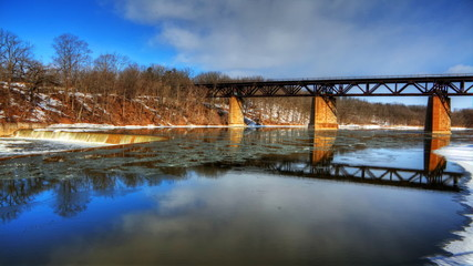 River,dam and railway bridge in winter, a timelapse