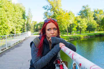 Thoughtful girl with red hair