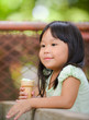 Cute girl Asian like to eat ice-cream