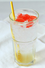 glass of lime soda drinks with red jelly