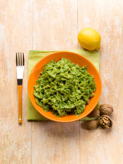 pasta with spinach pesto almond nuts and lemon peel