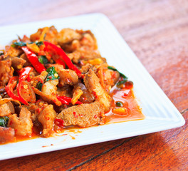 Thai food; Fried pork with spicy powder or curry poder