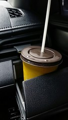 Cold coffee in glass hoder in car