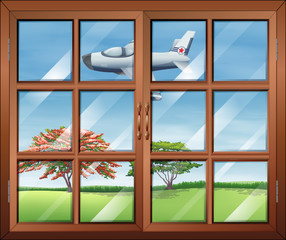 A window with a view of the airplane outside