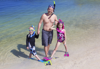 Family going Snorkeling at the Beach on vacation