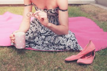 Young woman having tea outside