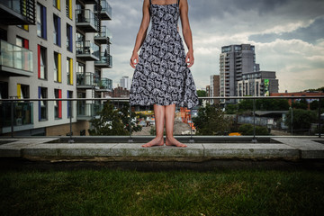 Young woman standing on roof