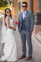 Cool bride and groom outdoors