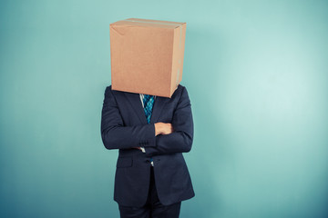 Businessman with a box on his head