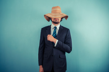 Businessman wearing a beach hat
