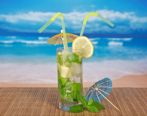 Fresh mojito, umbrella and spearmint leaf