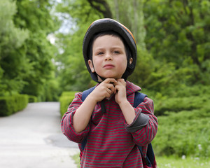 Child cyclist with helmet