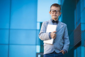kid with laptop on the blue modern background