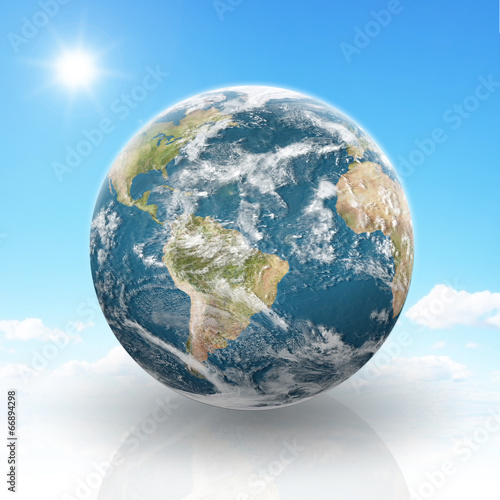 Planet Earth on a cloudy background - 66894298